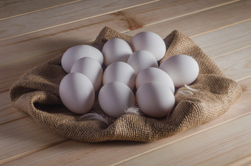 Eggs on sacking on wooden table