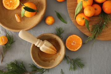 Juicy tangerines on grey background