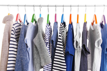 Hangers with different clothes, closeup