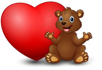Cartoon funny bear sitting with a big heart