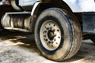 Tire on a big muddy truck