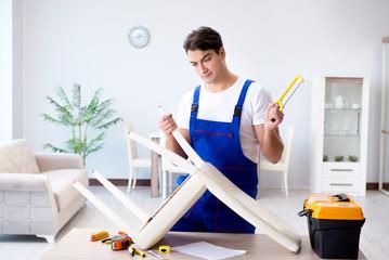 Man repairing chair in the room