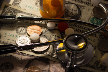 Money prescription medication pills and stethoscope medical, the cost of health care in america