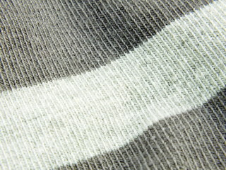 grey knitted wool socks background close up