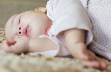 Portrait of a sleeping cute newborn baby