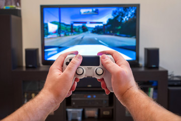 video game console controller in man hands
