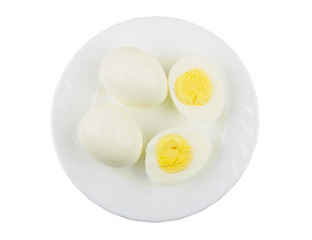 Full eggs and half of eggs in plate on white