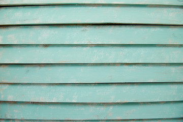 old wooden boards which are painted in blue color