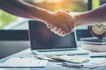 business partners handshaking after business success negotiation at meeting room