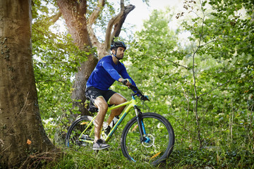 Man cycling on bike in forest