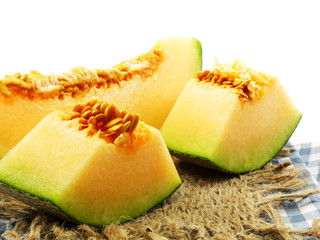 juicy honeydew melon on a wooden table background