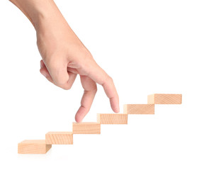 Hand liken business person stepping up  toy staircase