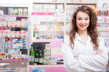 Pharmacist smiling at her work place
