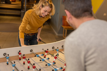 workers playing table football