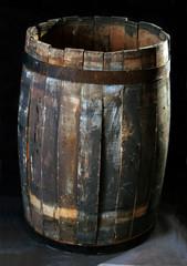 Old wooden barrels on a dark background