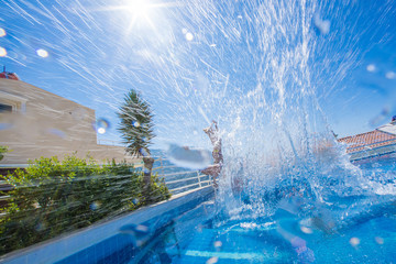 Man jumping in the pool with splashes