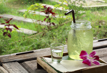 Lemon grass Juice on the outdoor wood table