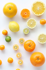 Various citrus fruits on white background