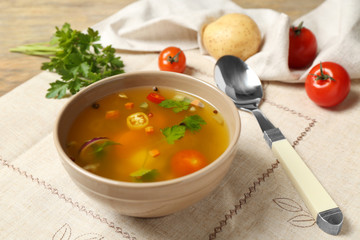 Bowl with fresh vegetable soup on napkin