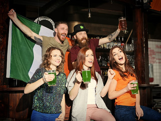 People celebrating Saint Patrick's Day in pub