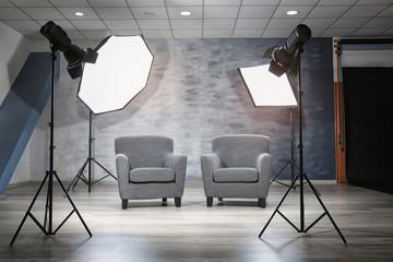 Photo studio with modern interior and lighting equipment