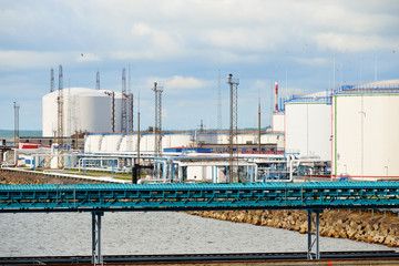 Oil storage tanks at Ventspils terminal on a clear summer day, Latvia
