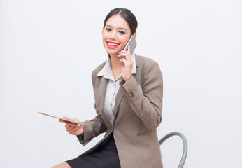 Businesswoman use of mobile phone. young woman used smart phone and tablet.