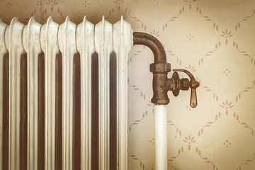 Retro styled image of an old central heating radiator