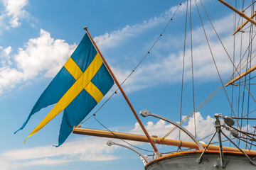 Swedish flag on the back of an old sailing ship