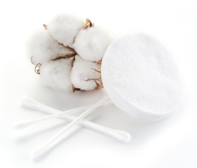 Fluffy cotton ball and cotton swabs and pads.