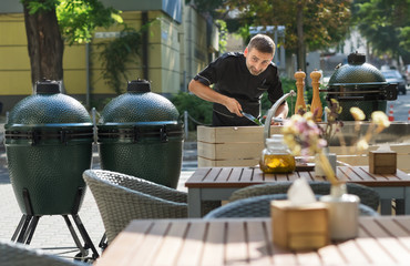 Barbecue chef tasting outdoor kitchens