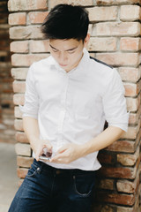 Young asian chinese man using technology