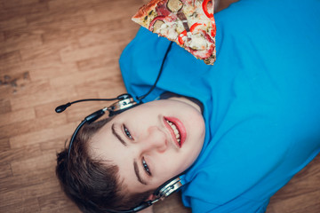 Teenager eating pizza.