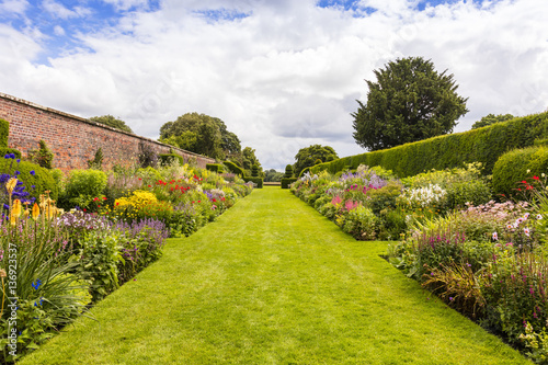 Herbaceous Border In A Well Tended Garden With Perennial Flowering Plants Stock Photo And