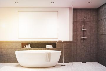 Bathroom with dark gray tiles, toned