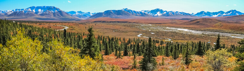 Scenic fall landscape with river and snow-capped mountains in Denali National Park, Alaska
