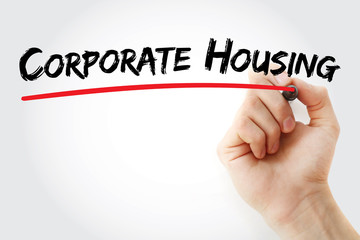 Hand writing corporate housing with marker, concept background