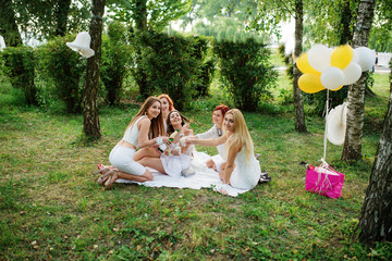 Five girls with champagne at hand weared on white dress on hen p