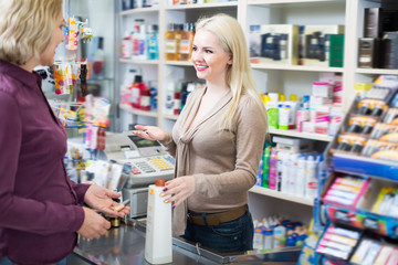 Poster Pharmacie Mature customer paying for purchases