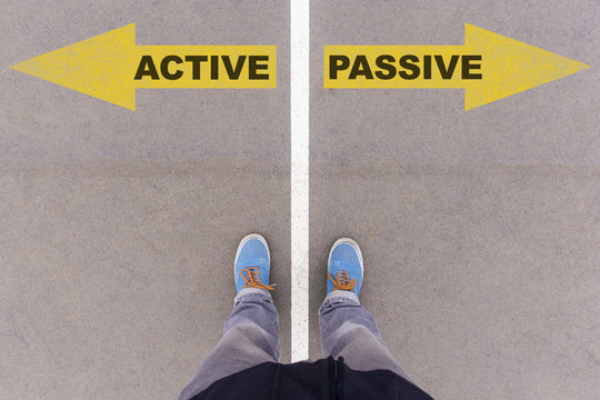 Active vs Passive text arrows on asphalt ground, feet and shoes