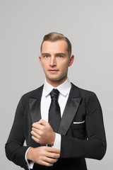 handsome businessman in fashionable suit in studio