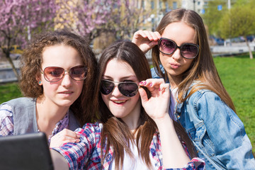 Happy teen girls having fun in street