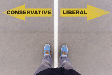 Conservative vs Liberal text arrows on asphalt ground, feet and