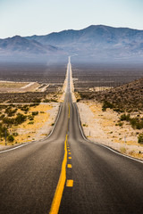 Fotobehang Route 66 Endless straight road in Death Valley National Park, California, USA