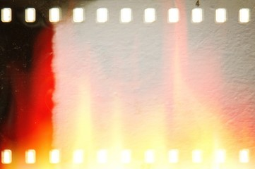Vintage film strip frame with fire and flames effects.