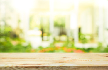 Empty wood table top on blur abstract green from garden background