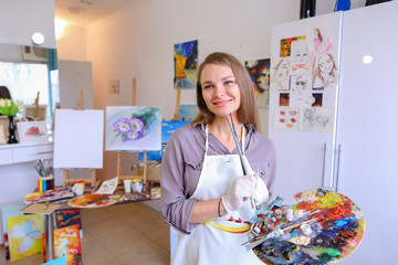 Women beautiful painter posing and smiling, laughing into camera