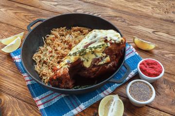 German restaurant food. Roasted pork leg with sauerkraut