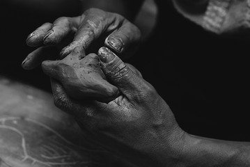 Hands stained with clay and paint. Hands painter and sculptor.