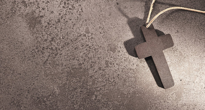 Holy christian cross on stone background for funeral card.